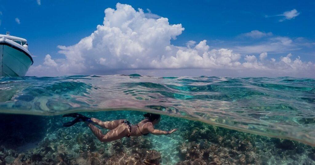 Snorkeling girl in liveaboard